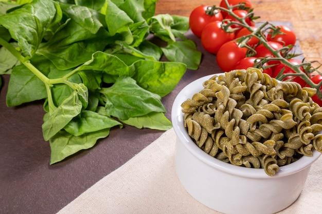 Raw spinach screw noodles, vegetarian, vegan . healthy food.