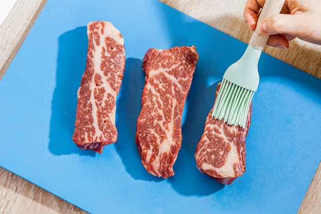 Raw steak smeared with brush oil