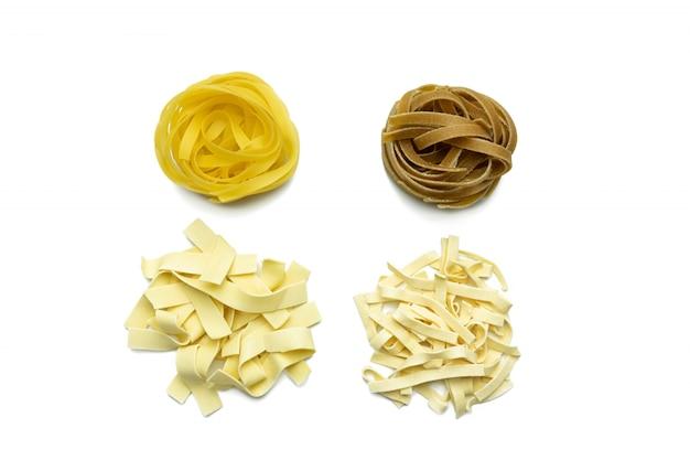 Raw tagliatelle pasta isolated on white