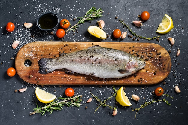 Raw trout on a wooden chopping board.