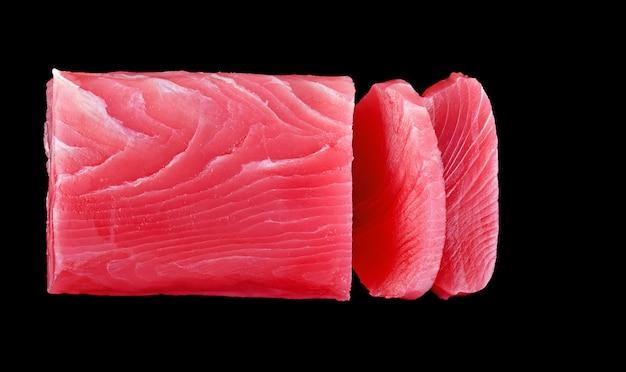 Raw tuna fish isolated on black background
