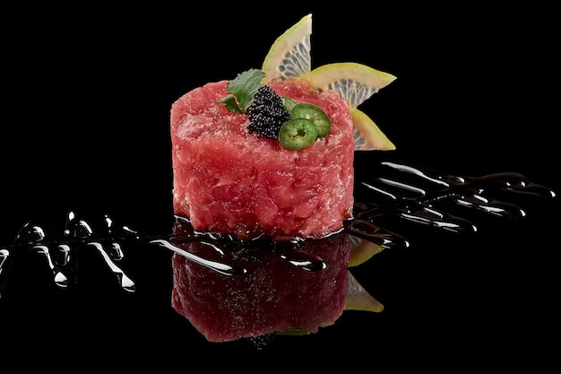 Raw tuna tartare with tobiko lime greens and soy sauce