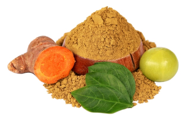 Raw turmeric, amla with henna powder and henna leaves over white background