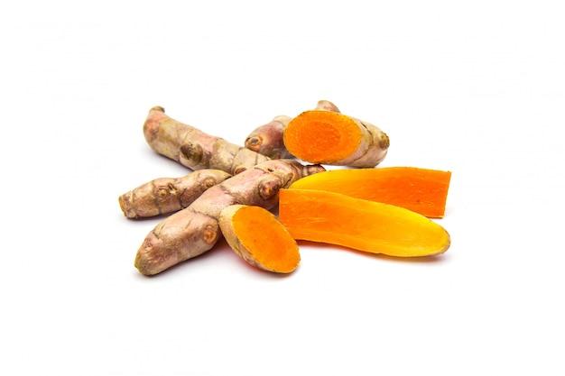 Raw turmeric (curcuma longa linn) ingredients for making herbal medicine isolated on white.