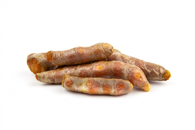 Raw turmeric (curcuma longa linn) on white