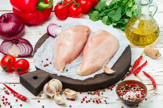Raw uncooked organic chicken fillet (breast)