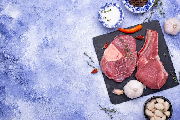 Raw uncooked ossobucco steak with spices