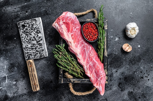 Raw veal calf short spare rib meat with thyme and rosemary