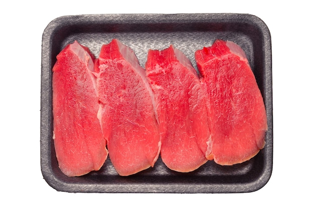 Raw veal in container isolated on white background. Premium Photo