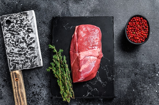 Raw veal meat steak fillet on a marble board