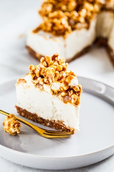 Raw vegan cashew cheesecake with caramel popcorn, raw vegan dessert concept,