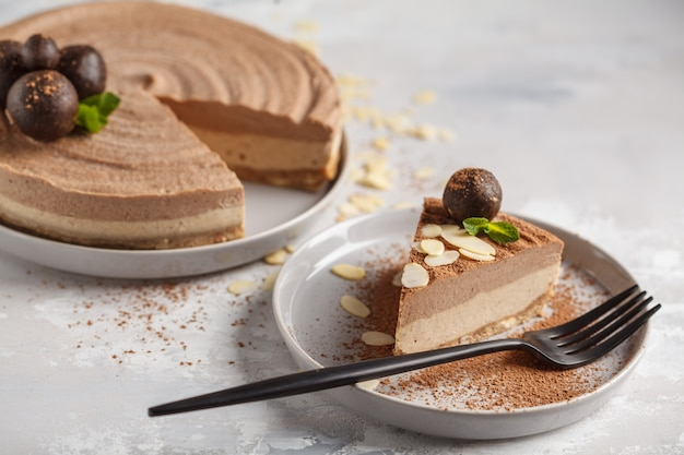 Raw vegan chocolate-caramel cheesecake with raw balls. healthy vegan food concept.