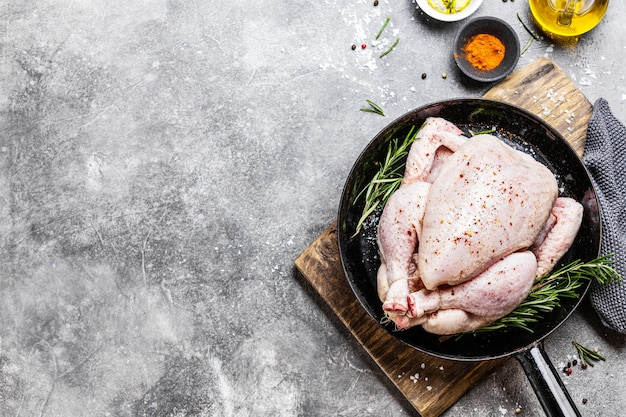 Raw whole chicken ready for cooking