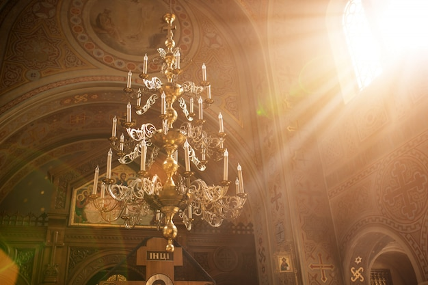 Rays of the sun light in the temple window