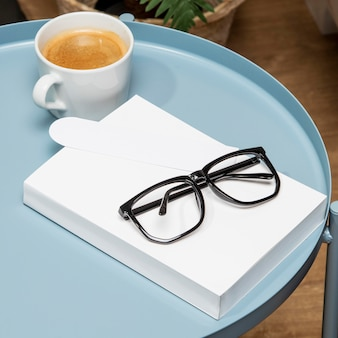 Reading glasses and copy space book