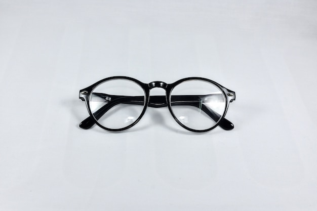Reading glasses on a white background.