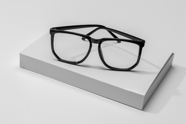 Reading glasses on white book