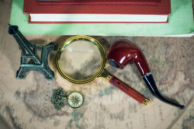 Reading magnifying glass map, vintage compass