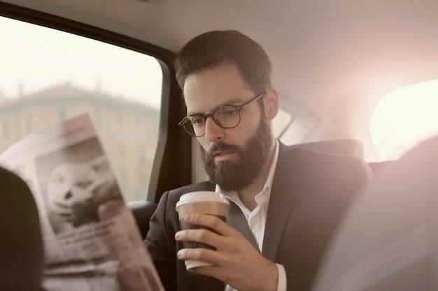 Reading news and having coffee