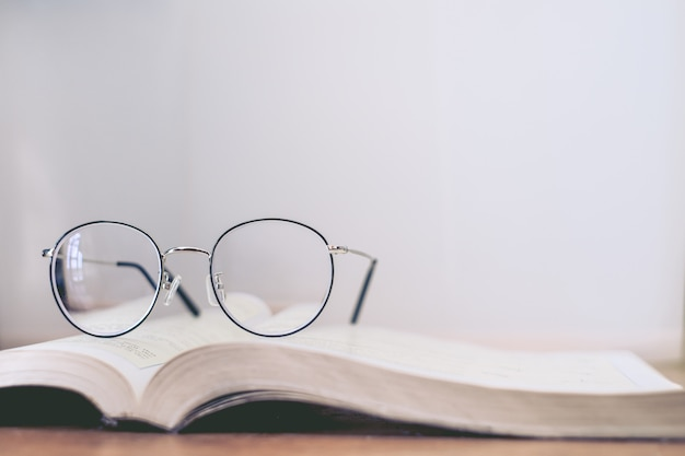 Reading thin frame glasses on book