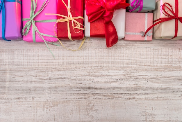 Ready for christmas. colorful presents on wooden table top view