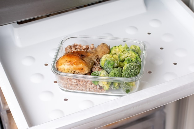 Ready frozen meal in a container in the refrigerator