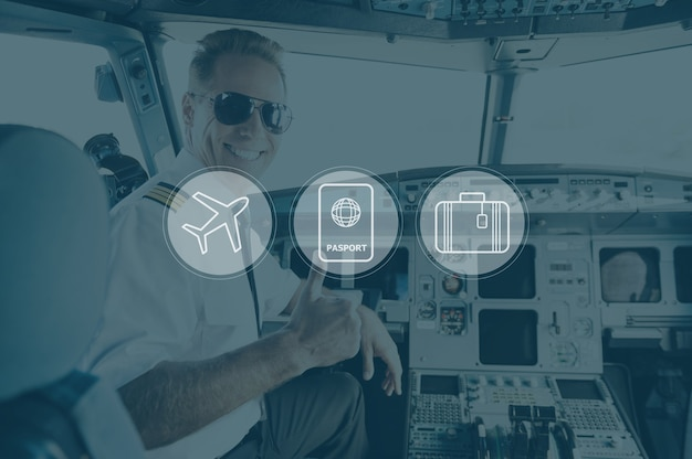 Готов к полету. вид сзади уверенного в себе пилота-мужчины, показывающего большой палец вверх и улыбающегося, сидя в кабине