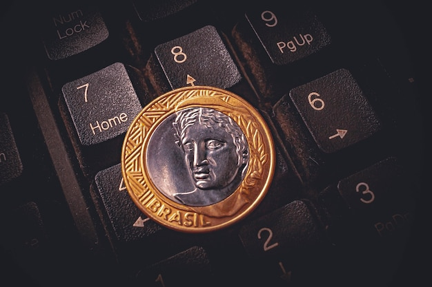 A real 1 coin on a computer keyboard