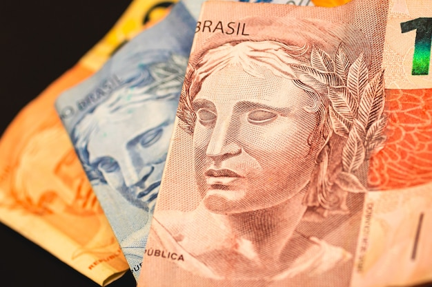 Real brl brazil money banknotes in photography close up with black background