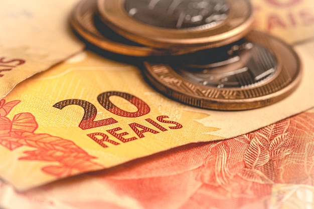 Real brl the brazilian banknotes and coins in close up