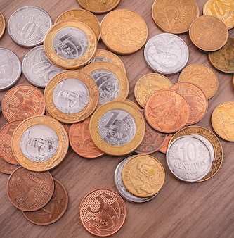 Real brl brazilian coins on a wooden furniture with a view from the top