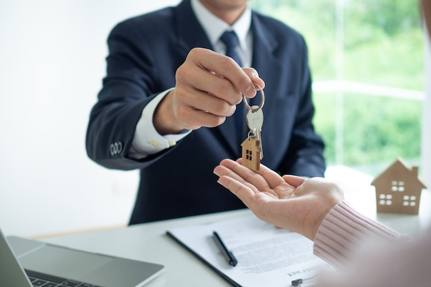 Real estate agent gives key to house