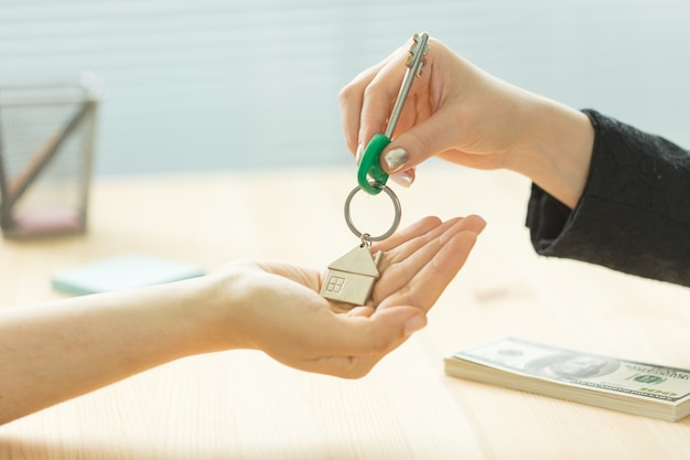 Real estate agent giving key to new owner