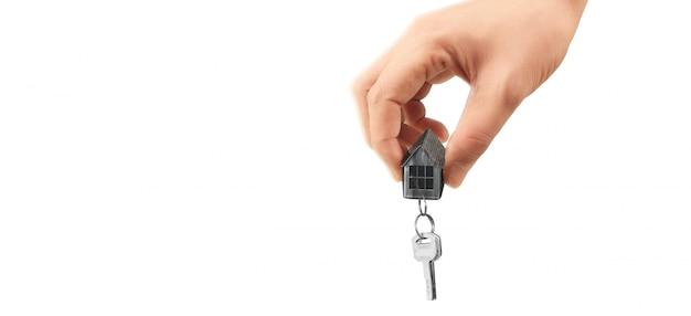 Real estate agent handing over house keys in hand