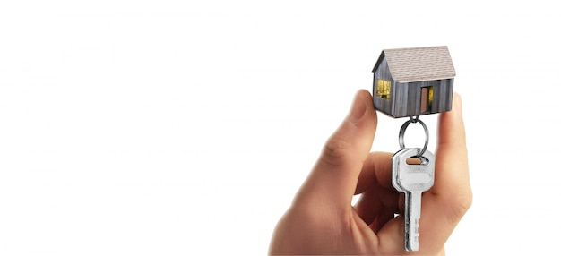 Real estate agent handing over house keys in hand