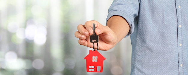 Real estate agent handing over a house keys in hand