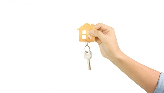 Real estate agent handing over house keys