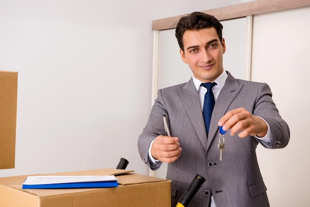 Real estate agent with key from new house