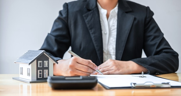 Real estate agent working sign agreement document contract for house insurance