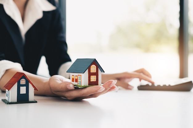 Real estate broker agent being analysis and making the decision a home estate loan to cust