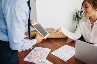 Real estate business people with tablet