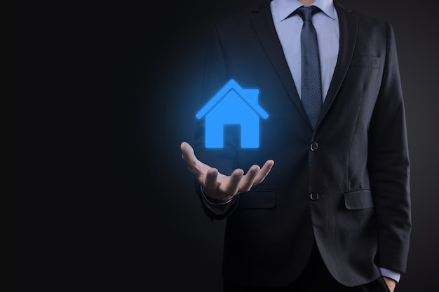 Real estate concept, businessman holding a house icon.house on hand.property