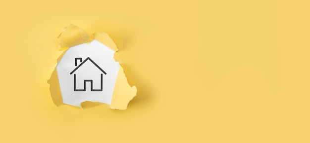 Real estate concept, businessman holding a house icon