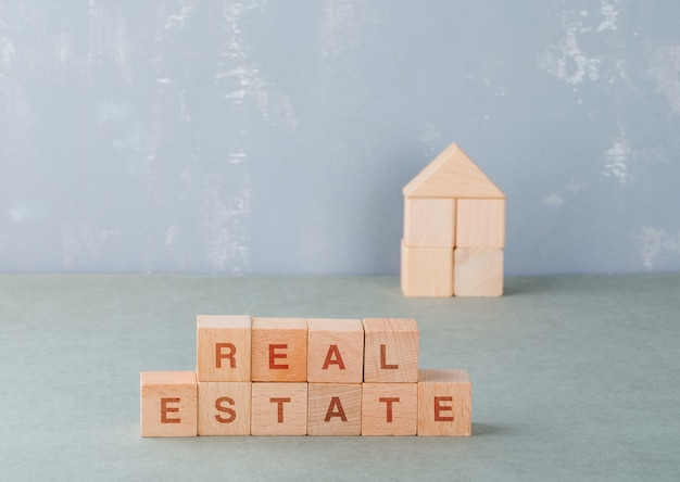 Real estate concept with wooden blocks with words