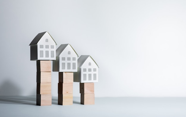 Real estate concepts with model house on wood box
