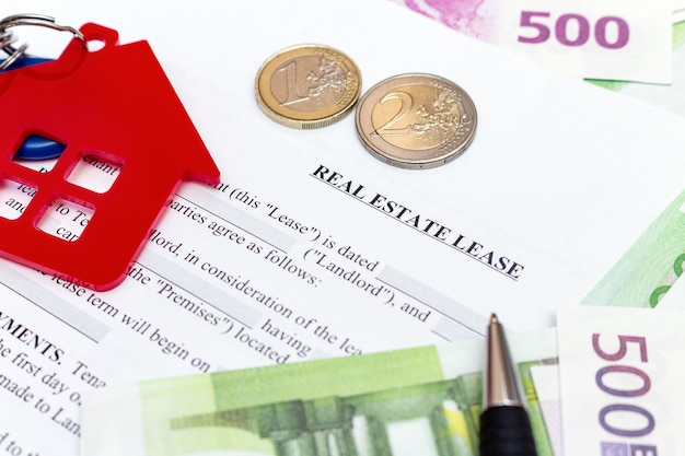 Real estate contract, money and house keychain