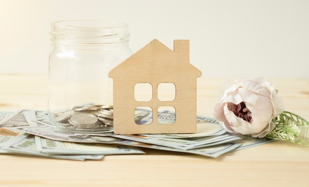 Real estate finance concept - money glass with new home word