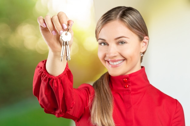Real estate. happy broker. attractive young woman holding keys