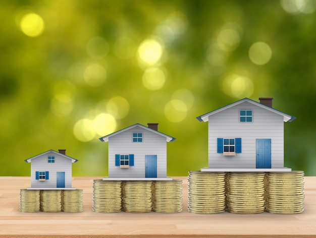 Real estate investment concept with mock up houses and gold coins