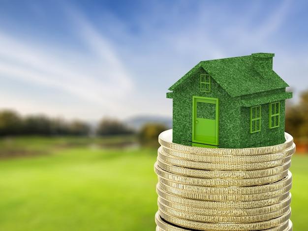 Инвестиции в недвижимость с зеленым домом и стопкой золотых монет